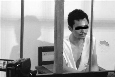 8月23日,周禄宝在苏州市第一看守所接受民警讯问。新京报记者 宋识径 摄